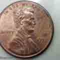 Size of a baby bed bug next to a penny
